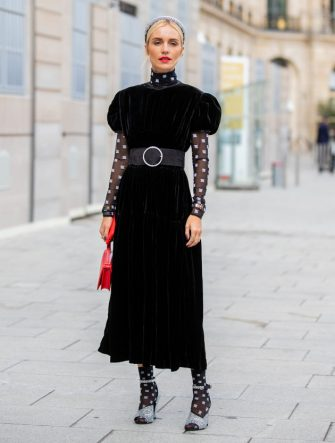 PARIS, FRANCE - SEPTEMBER 25: A guest is seen wearing red bag, sheer socks, velvet dress outside Guy Laroche during Paris Fashion Week Womenswear Spring Summer 2020 on September 25, 2019 in Paris, France. (Photo by Christian Vierig/Getty Images)