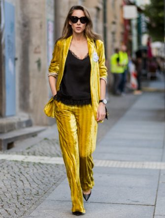 BERLIN, GERMANY - JULY 06: Alexandra Lapp wearing a yellow velvet Dorothee Schumacher suit during the Mercedes-Benz Fashion Week Berlin Spring/Summer 2018 at Kaufhaus Jandorf on July 6, 2017 in Berlin, Germany. (Photo by Christian Vierig/Getty Images)