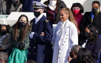 WASHINGTON, DC - JANUARY 20: Jennifer Lopez is escorted to the inauguration of U.S. President-elect Joe Biden on the West Front of the U.S. Capitol on January 20, 2021 in Washington, DC.  During today's inauguration ceremony Joe Biden becomes the 46th president of the United States. (Photo by Alex Wong/Getty Images)