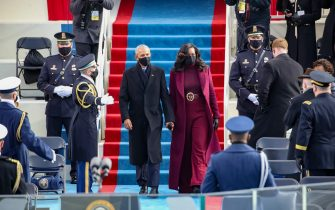 WASHINGTON, DC - JANUARY 20:  Former U.S. President Barack Obama and Michelle Obama at the inauguration of U.S. President-elect Joe Biden on the West Front of the U.S. Capitol on January 20, 2021 in Washington, DC.  During today's inauguration ceremony Joe Biden becomes the 46th president of the United States. (Photo by Rob Carr/Getty Images)