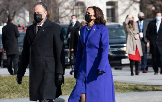 WASHINGTON, DC - JANUARY 20: U.S. Vice President-elect Kamala Harris (R) arrives with her husband Doug Emhoff for the inauguration of U.S. President-elect Joe Biden on January 20, 2021 in Washington, DC.  During today's inauguration ceremony Joe Biden becomes the 46th president of the United States. (Photo by Rod Lamkey - Pool/Getty Images)