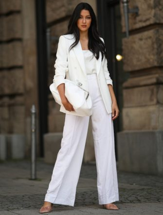 MUNICH, GERMANY - JULY 21: Rebecca Mir wearing Max Mara suit and bag, Atelier Swarovski jewelry and Midnight 00 heels on July 21, 2020 in Munich, Germany. (Photo by Jeremy Moeller/Getty Images)