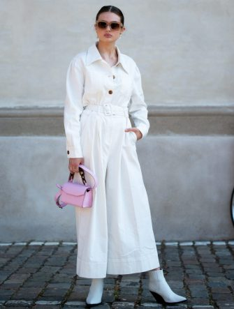 COPENHAGEN, DENMARK - AUGUST 11: Emilie Billington outside Remain Birger Christensen wearing white jumpsuit and pink bag during Copenhagen fashion week SS21on August 11, 2020 in Copenhagen, Denmark. (Photo by Raimonda Kulikauskiene/Getty Images)