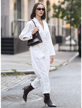 NEW YORK, NEW YORK - SEPTEMBER 18: Mary Leest is seen wearing an Alex Mill jumpsuit, Tiffany necklace, Staud bag and Tony Bianco boots during New York Fashion Week S/S21 on September 18, 2020 in New York City. (Photo by Daniel Zuchnik/Getty Images)