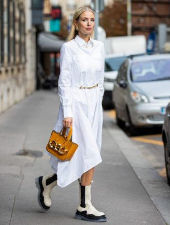 PARIS, FRANCE - OCTOBER 08: Leonie Hanne is seen wearing white J.W. Anderson blouse dress, J.W. Anderson bag, Bottega Veneta boots during a Street Style Fashion Photo Session on October 08, 2020 in Paris, France. (Photo by Christian Vierig/Getty Images)