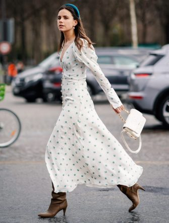 PARIS, FRANCE - MARCH 05: A guest wears a headband, a white dress with printed blue flowers, a white Chanel bag, outside Chanel, during Paris Fashion Week Womenswear Fall/Winter 2019/2020, on March 05, 2019 in Paris, France. (Photo by Edward Berthelot/Getty Images)