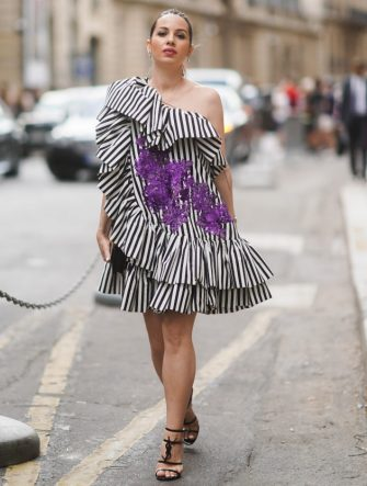 PARIS, FRANCE - JULY 01: Maria Rosaria Rizzo wears an off-shoulder black and white striped dress with purple printed flowers, YSL shoes, outside Ralph & Russo, during Paris Fashion Week -Haute Couture Fall/Winter 2019/2020, on July 01, 2019 in Paris, France. (Photo by Edward Berthelot/Getty Images)