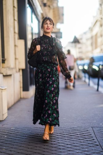 PARIS, FRANCE - JULY 03: Jeanne Damas wears a floral print black mesh dress, a bag, outside Valentino, during Paris Fashion Week -Haute Couture Fall/Winter 2019/2020, on July 03, 2019 in Paris, France. (Photo by Edward Berthelot/Getty Images)