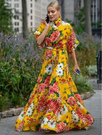 NEW YORK, NY - SEPTEMBER 09: A guest wearing a yellow flower pattern dress attends the Carolina Herrera show during New York Fashion Week at the Garden of the Battery on September 9, 2019 in New York City. (Photo by David Dee Delgado/Getty Images)