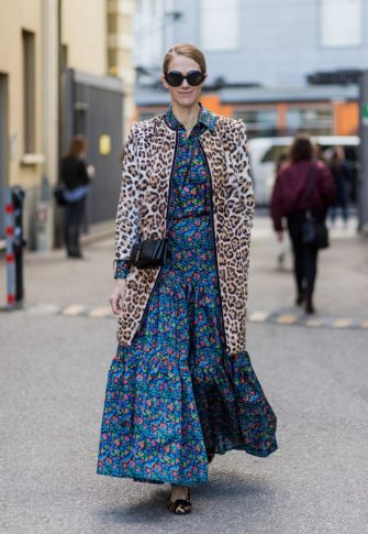 MILAN, ITALY - FEBRUARY 25: JJ Martin wearing a blue dress with floral print, leopard coat outside Missoni during Milan Fashion Week Fall/Winter 2017/18 on February 25, 2017 in Milan, Italy. (Photo by Christian Vierig/Getty Images)