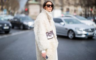 PARIS, FRANCE - MARCH 05: Julie Pelipas is seen wearing white turtleneck, white teddy jacket, brown mini Celine bag outside Miu Miu during Paris Fashion Week Womenswear Fall/Winter 2019/2020 on March 05, 2019 in Paris, France. (Photo by Christian Vierig/Getty Images)