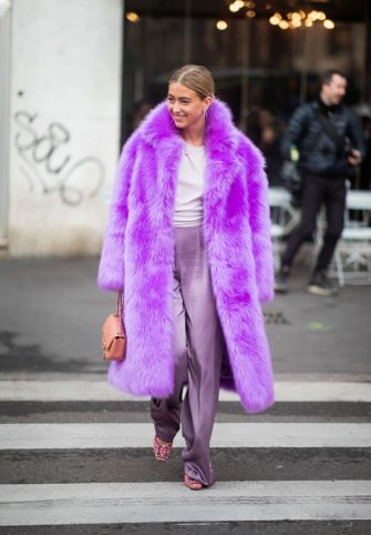 MILAN, ITALY - FEBRUARY 21: Emili Sindely is seen wearing purple faux fur coat outside Max Mara on Day 2 Milan Fashion Week Autumn/Winter 2019/20 on February 21, 2019 in Milan, Italy. (Photo by Christian Vierig/Getty Images)