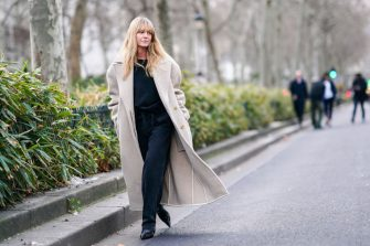 PARIS, FRANCE - JANUARY 19: Jeanette Madsen wears a black top, a cream-color oversized wool coat, black pants, black pointy boots, outside Paul Smith, during Paris Fashion Week - Menswear Fall/Winter 2020-2021 on January 19, 2020 in Paris, France. (Photo by Edward Berthelot/Getty Images)