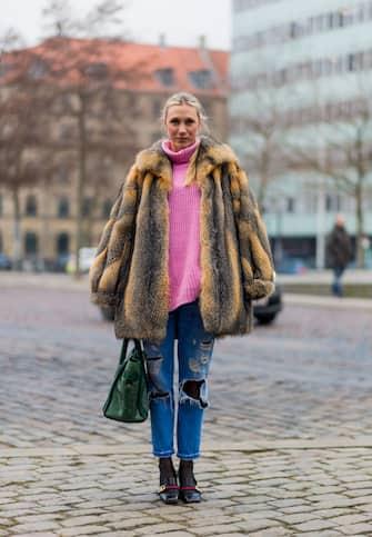 COPENHAGEN, DENMARK - FEBRUARY 02: Lena-Sophie Krups wearing a fur jacket, ripped denim jeans, green Balenciaga bag, pink knit, Gucci shoes during the Copenhagen Fashion Week Autumn/Winter 17 on February 2, 2017 in Copenhagen, Denmark. (Photo by Christian Vierig/Getty Images)