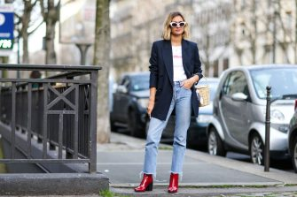 PARIS, FRANCE - MARCH 02:  Anne-Laure Mais, fashion blogger from Adenorah, wears a black jacket, a white top, blue denim jeans pants, and red shoes, outside the Alexis Mabille show, during Paris Fashion Week Womenswear Fall/Winter 2017/2018, on March 2, 2017 in Paris, France.  (Photo by Edward Berthelot/Getty Images)