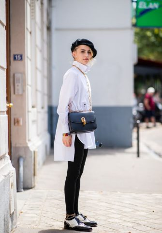 PARIS, FRANCE - JULY 02: Caroline Daur wearing white button shirt, black beret, black leggings is seen outside Dior on day two during Paris Fashion Week Haute Couture FW18 on July 2, 2018 in Paris, France. (Photo by Christian Vierig/Getty Images)