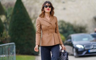 PARIS, FRANCE - FEBRUARY 27:  Jeanne Damas wears a brown jacket, sunglasses, flare pants, a bag, outside Dior, during Paris Fashion Week Womenswear Fall/Winter 2018/2019, on February 27, 2018 in Paris, France.  (Photo by Edward Berthelot/Getty Images)