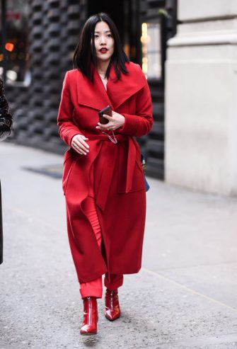 NEW YORK, NEW YORK - FEBRUARY 08: A guest is seen wearing a red Hellessy outfit outside the Hellessy show during New York Fashion Week: A/W20 on February 08, 2020 in New York City. (Photo by Daniel Zuchnik/Getty Images)