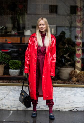 PARIS, FRANCE - MARCH 02: Thora Valdimars is seen wearing red varnished coat, overall, black bag outside Sacai during Paris Fashion Week - Womenswear Fall/Winter 2020/2021 : Day Eight on March 02, 2020 in Paris, France. (Photo by Christian Vierig/Getty Images)