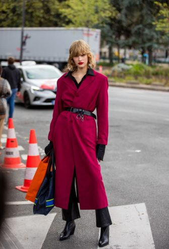 PARIS, FRANCE - OCTOBER 03: A model is seen wearing red belted coat outside Hermes during Paris Fashion Week - Womenswear Spring Summer 2021 : Day Six on October 03, 2020 in Paris, France. (Photo by Christian Vierig/Getty Images)