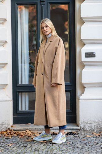 BERLIN, GERMANY - OCTOBER 29: Alessa Winter is seen wearing a cream colored turtleneck and oversized camel wool coat by Weekday, denim jeans by Closed and sneakers by Premiata on October 29, 2019 in Berlin, Germany. (Photo by Brian Dowling/Getty Images)