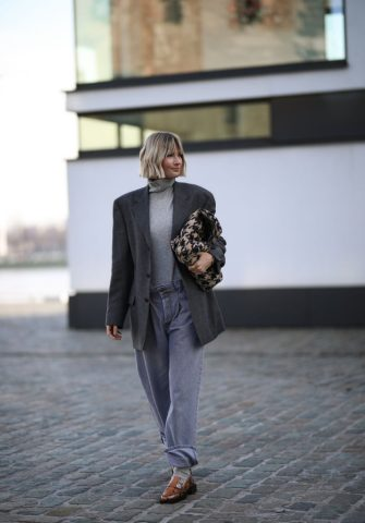 COLOGNE, GERMANY - MARCH 07: Kathrin Bommann (viva_la_wow) wearing vintage ysl blazer, Raey pants, Uniqlo turtleneck, Chanel bag and Ganni loafer on March 07, 2020 in Cologne, Germany. (Photo by Jeremy Moeller/Getty Images)