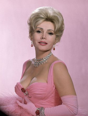 Actress Zsa Zsa Gabor wearing vulture feathers and $600,000 worth of jewelry for a Dune's Club appearance in   Las Vegas, Nevada 1961. (Photo by The LIFE Picture Collection via Getty Images)
