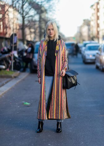 MILAN, ITALY - JANUARY 16: Linda Tol wearing a mulit color striped coat, black bag, black hoody at Etro during Milan Men's Fashion Week Fall/Winter 2017/18 on January 16, 2017 in Milan, Italy. (Photo by Christian Vierig/Getty Images)