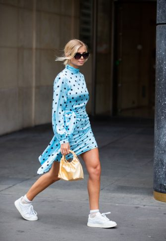 PARIS, FRANCE - JULY 01: Xenia Adonts is seen wearing blue dress with dots print, yellow bag outside Schiaparelli during Paris Fashion Week - Haute Couture Fall/Winter 2019/2020 on July 01, 2019 in Paris, France. (Photo by Christian Vierig/Getty Images)