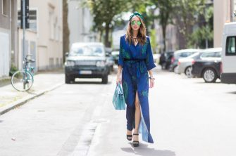 DUESSELDORF, GERMANY - AUGUST 4: Model and fashion blogger Alexandra Lapp wearing a blue Kimono maxi dress with green leaf print from Borgo de Nor, green metallic Aviator sunglasses by Ray-Ban, plateau heels from Prada, Milla MCM bag in turquoise, a green bandana turban, neck ripe and bracelet in grey gold by Schubart Goldschmiede, three rings in grey gold with a green Tourmaline by Schubart on August 4, 2017 in Duesseldorf, Germany. (Photo by Christian Vierig/Getty Images)