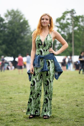 CHICAGO, IL - JULY 22:  A guest is seen attending Pitchfork Music Festival wearing leaf pattern bodysuit with denim jacket around the waist at Union Park on July 22, 2018 in Chicago, Illinois.  (Photo by Matthew Sperzel/Getty Images)