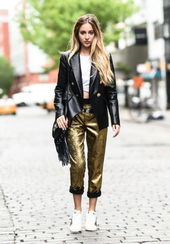 NEW YORK, NY - MAY 11:  Fashion Blogger Rosa Crespo is seen in Noho wearing an Iorane World t-shirt, Nude black jacket, Nude gold pants, Ash sneakers and Salar Milano bag on May 11, 2017 in New York City.  (Photo by Daniel Zuchnik/Getty Images)