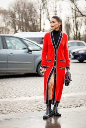 PARIS, FRANCE - MARCH 03: Camila Coelho wearing red Chanel cardigan dress, black bag and black ankle boots outside the Chanel show during Paris Fashion Week Womenswear Fall/Winter 2020/2021 Day Nine on March 03, 2020 in Paris, France. (Photo by Hanna Lassen/Getty Images)