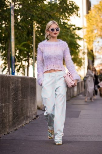 PARIS, FRANCE - SEPTEMBER 29:  Caroline Daur, wearing a pink sweater, light blue and light pink polka dot pants, pink bag and printed shoes, is seen before the Haider Ackermann show on September 29, 2018 in Paris, France. (Photo by Claudio Lavenia/Getty Images)