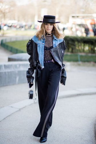 PARIS, FRANCE - MARCH 03: Lena Perminova wearing cowboy hat, sheer top, denim jacket is seen outside Elie Saab during Paris Fashion Week Womenswear Fall/Winter 2018/2019 on March 3, 2018 in Paris, France. (Photo by Christian Vierig/Getty Images)