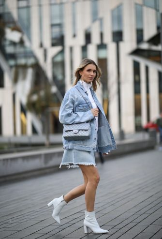 DUSSELDORF, GERMANY - FEBRUARY 18: Scarlett Gartmann wearing Givenchy skirt and jacket, Weekday sweater, Gianvito Rossi boots and Chanel bag on February 18, 2020 in Dusseldorf, Germany. (Photo by Jeremy Moeller/Getty Images)