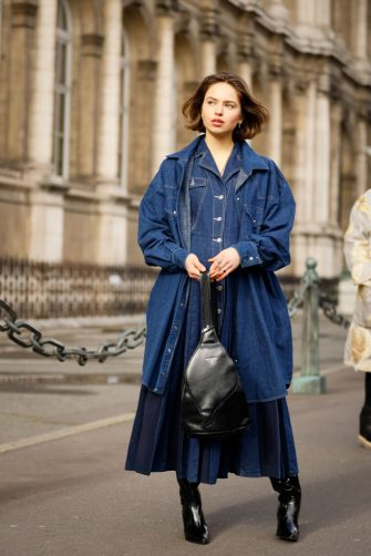 PARIS, FRANCE - FEBRUARY 29: A guest wearing denim dress, denim matching shirt jacket, black leather Prada bag and black pointy boots outside Vivienne Westwood show during Paris Fashion week Womenswear Fall/Winter 2020/2021 Day Six on February 29, 2020 in Paris, France. (Photo by Hanna Lassen/Getty Images)