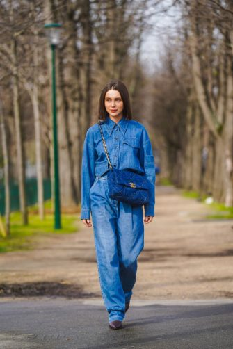 PARIS, FRANCE - MARCH 03: Mary Leest wears a blue denim shirt, a blue large quilted Chanel bag, blue denim jeans, pointy leather brown shoes, outside Chanel, during Paris Fashion Week - Womenswear Fall/Winter 2020/2021 on March 03, 2020 in Paris, France. (Photo by Edward Berthelot/Getty Images)
