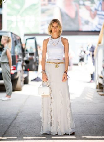 BERLIN, GERMANY - JULY 05: Lisa Hahnbueck wearing ruffled maxi skirt, white top, white Chanel bag seen outside Lana Mueller during the Berlin Fashion Week July 2018 on July 5, 2018 in Berlin, Germany. (Photo by Christian Vierig/Getty Images)