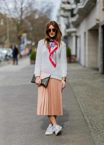 BERLIN, GERMANY - MARCH 29: Fashion blogger Sofia Grau is wearing a salmon pink skirt from Zara, white sneakers from Adidas, a grey sweater from Mango, a pink black clutch from Lancel Paris, a red grey scarf from Chanel, sunglasses from Rayban clubround, watch Kapten & Son on March 29, 2016 in Berlin, Germany (Photo by Christian Vierig/Getty Images)