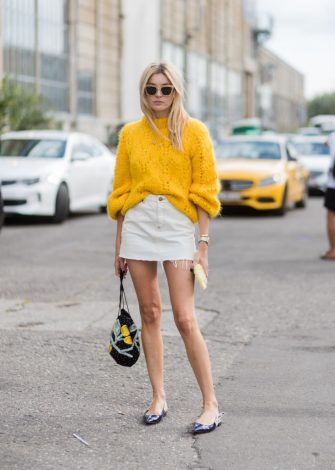 COPENHAGEN, DENMARK - AUGUST 10: Camille Charriere wearing a yellow knit, mini skirt outside Ganni on August 10, 2017 in Copenhagen, Denmark. (Photo by Christian Vierig/Getty Images)