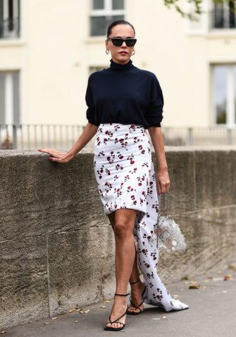 PARIS, FRANCE - SEPTEMBER 26: Evangelie Smyrniotaki is seen wearing a blue sweater, floral white skirt and Paco Rabanne clear purse outside the Paco Rabanne show during Paris Fashion Week SS20 on September 26, 2019 in Paris, France. (Photo by Daniel Zuchnik/Getty Images)