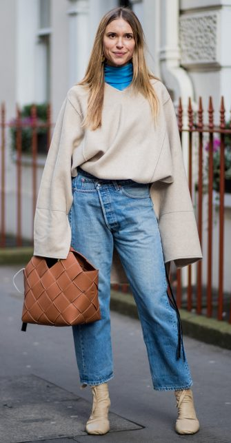 LONDON, ENGLAND - FEBRUARY 16: Pernille Teisbaek wearing denim jeans blue turtleneck, creme white sweater with long sleeves seen, brown bag outside Mulberry during London Fashion Week February 2018 on February 16, 2018 in London, England. (Photo by Christian Vierig/Getty Images)