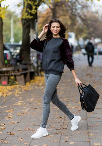 BERLIN, GERMANY - NOVEMBER 09: Fata Hasanovic (@fata.hasanovic / model germanys next topmodel) wearing a sassy classy scarf, a grey purple velvet sweater, grey skinny Dr. Denim jeans, white Nike sneaker, black Asos bag on November 9, 2016 in Berlin, Germany. (Photo by Christian Vierig/Getty Images)