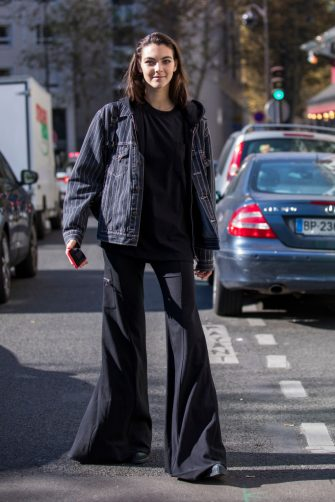 PARIS, FRANCE - SEPTEMBER 27:  Vittoria Ceretti, wearing a pinstripe jacket, a black hoody and black pants, is seen after the Chloe show on September 27, 2018 in Paris, France. (Photo by Claudio Lavenia/Getty Images)