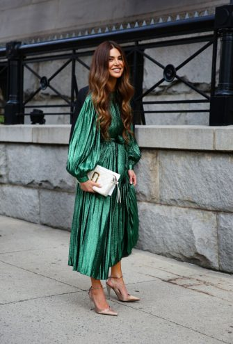 NEW YORK, NEW YORK - SEPTEMBER 11: A guest arrives at the Marc Jacobs show during New York Fashion Week wearing a green dress and white handbag on September 11, 2019 in New York City. (Photo by Donell Woodson/Getty Images)