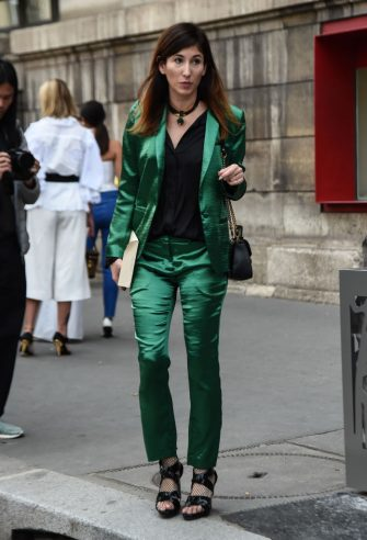 PARIS, FRANCE - SEPTEMBER 30: A guest is seen wearing a green Giambattista Valli suit outside the Giambattista Valli show during Paris Fashion Week SS20 on September 30, 2019 in Paris, France. (Photo by Daniel Zuchnik/Getty Images)