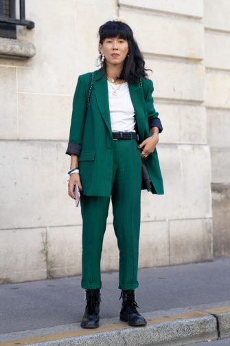 PARIS, FRANCE - SEPTEMBER 24:  A guest is seen on the street during Paris Fashion Week SS19 wearing green suit on September 24, 2018 in Paris, France.  (Photo by Matthew Sperzel/Getty Images)