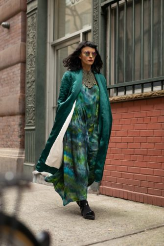 NEW YORK, NEW YORK - FEBRUARY 07: A guest is seen on the street during New York Fashion Week AW19 wearing sea green coat, tie dye dress and sunglasses on February 07, 2019 in New York City. (Photo by Matthew Sperzel/Getty Images)