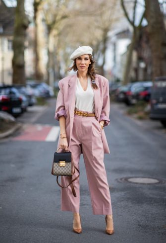 DUSSELDORF, GERMANY - FEBRUARY 19: (EDITORS NOTE: Image has been digitally enhanced.) Alexandra Lapp is seen wearing FRANKIE SHOP Pernille single-breasted blazer and Pernille high-rise pants in pastel pink, vintage beret in off white, GUCCI logo belt in camel, GUCCI monogram backpack in black and brown, GUCCI hair clips, CHRISTIAN LOUBOUTIN Kate pumps in camel, vintage Rolex Yachtmaster Yacht-Master in yellow gold and Tiffany T Square bangle in rose-gold on February 19, 2021 in Dusseldorf, Germany. (Photo by Christian Vierig/Getty Images)